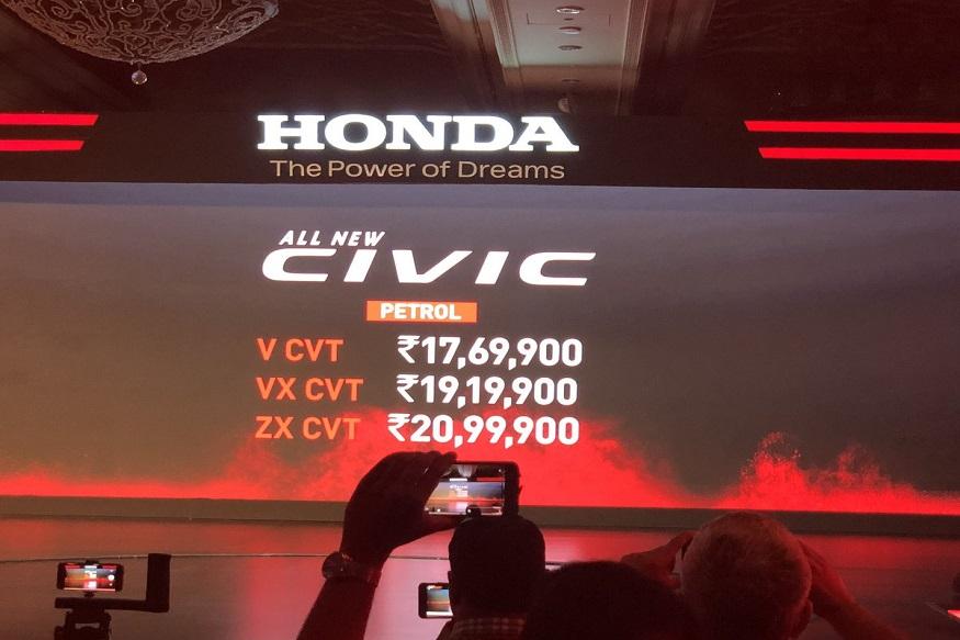 भारत में होंडा की सबसे लोकप्रिय कार में से एक Honda Civic लंबे अरसे बाद एक बार लॉन्च हुई. Honda Civic को दो वेरिएंट पेट्रोल और डीजल में पेश किया गया है. पेट्रोल वेरिएंट 1.8 लीटर इंजन और CVT (स्वचालित) ट्रांसमिशन के साथ आएगा, जबकि डीजल वेरिएंट 1.6 लीटर टर्बो इंजन और मैनुअल 6 स्पीड ट्रांसमिशन के साथ आएगा. इसकी कीमत 17,69,900 लाख रुपये से शुरू है. कंपनी नई होंडा सिविक पर तीन साल की अनलिमिटेड किलोमीटर वारंटी दे रही है जिसे बढ़ाकर 4 और 5 साल किया जा सकता है.