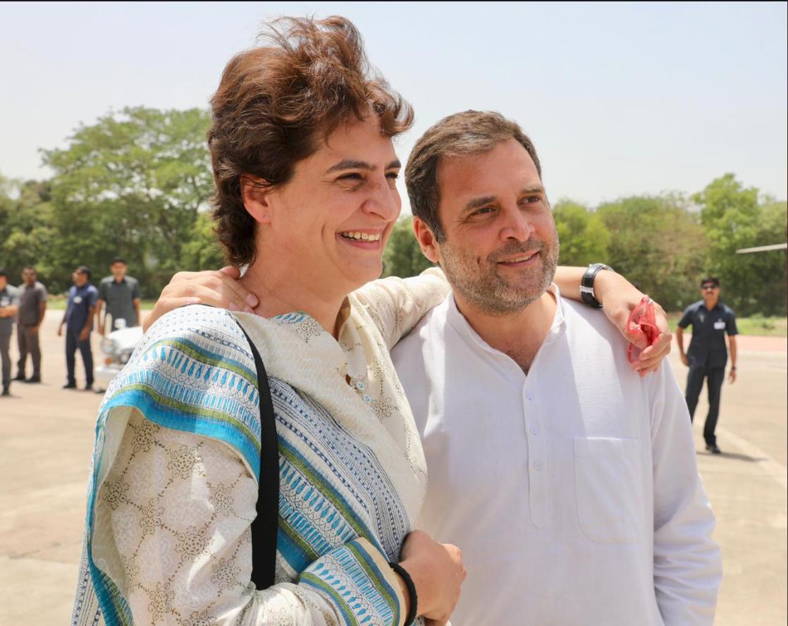 कांग्रेस अध्यक्ष राहुल गांधी और पार्टी महासचिव प्रियंका गांधी लोकसभा चुनाव में अपनी पार्टी को जीत दिलाने की कोशिश में लगे हैं. इसी बीच शनिवार को दोनों कानपुर के एक हेलिपैड पर अलग अंदाज में दिखे, इस दौरान राहुल ने एक अच्छे भाई होने का मतलब बताया.