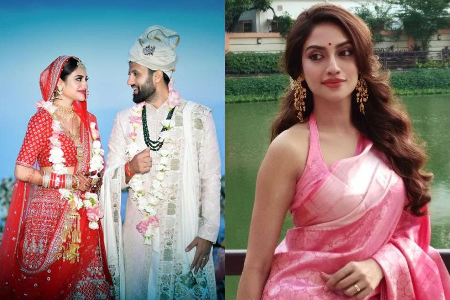 बांग्ला फिल्मों की मशहूर ऐक्ट्रेस और पश्चिम बंगाल के बशीरघाट से तृणमूल कांग्रेस की सांसद नुसरत जहां (28) शादी के बंधन में बंध गई हैं. तृणमूल कांग्रेस की इस सांसद ने अभी सदन में आकर शपथ ग्रहण नहीं की है. नई सरकार के पहला संसदीय सत्र बीते 17 जून को शुरू हुआ था. इसमें शुरुआती दो दिनों में नये सांसदों को पद की शपथ दिलाई गई. इस दौरान टीएमसी के सांसदों का शपथ ग्रहण सबसे ज्यादा चर्चित हुआ. क्योंकि टीएमसी के सांसदों के शपथ ग्रहण के दौरान जमकर जय श्रीराम के नारे लगाए गए. लेकिन नुसरत इस दौरान हल्दी-चंदन लगाकर अपनी शादी की तैयारियों में व्यस्त रहीं. बुधवार को उन्होंने पूरे हिन्दू रीति रिवाज से शादी रचाई. आइए जानते हैं उनके बारे में सबकुछ.