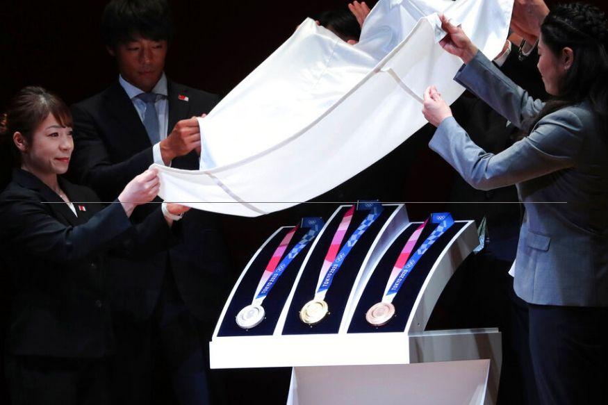ओलिंपिक शुरू होने से एक साल पहले मेडल्स का अनावरण किया गया (AP)