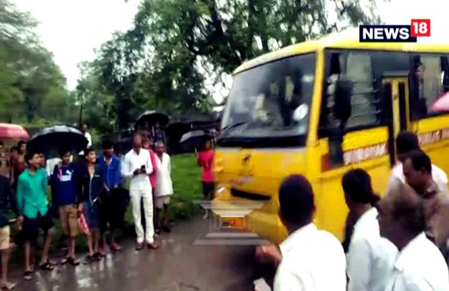 school bus crossing overflowing bridge sehore