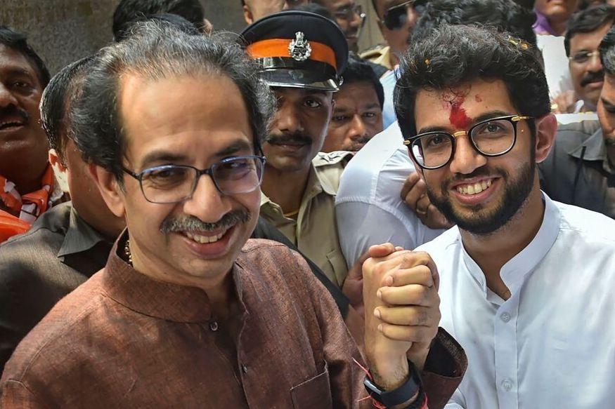 Mumbai: Shiv Sena President Uddhav Thackeray holds the hand of his son and Yuva Sena President Aditya Thackeray, after the former filed his nominations papers from Worli seat for upcoming Maharashtra Assembly elections, in Mumbai, Thursday, Oct. 3, 2019. (PTI Photo/Mitesh Bhuvad)(PTI10_3_2019_000067B)