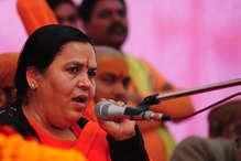 उमा भारती बोलीं, 'हम हेलीकॉप्टर से नहीं अपने कर्मों से उड़ते हैं'