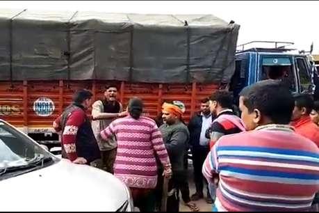 VIDEO : महिला ने दिखाई दबंगई, ट्रक चालक से भिड़ी