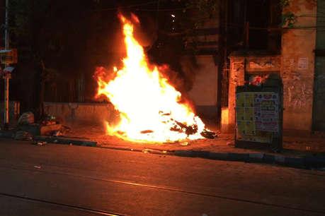 कोलकाता में शाह के वाहन पर हमला, गाड़ियां फूंकीं, रोड शो पर पथराव